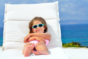 Toddler girl on sunbed