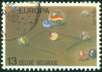 stamp printed in Belgium shows marbles