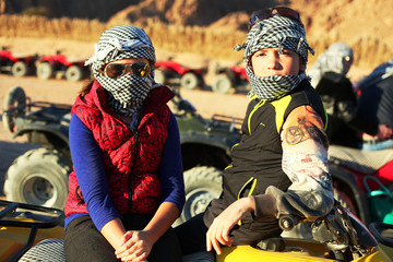 brother and sister childern in quad bike safari trip into desert