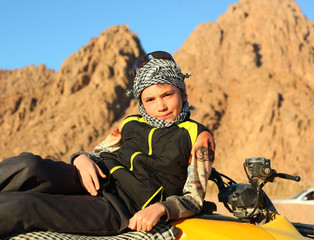 handsome preteen boy on quad bike safari trip