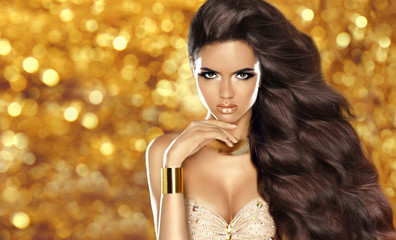 Fashion brunette girl with Long wavy hair, beauty makeup, luxury