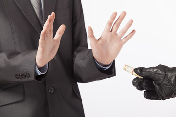 Business concept - a man in a suit does not accept a bribe