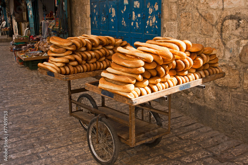 Fotobehang Brood Cart of bread in the streets of Old Jerusalem.