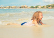 Little girl having fun on beach vacation. Place for text.