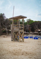 Empty lifeguard tower on the beach.