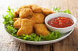 chicken nuggets with ketchup - 77464124