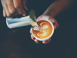 cup of coffee latte art in coffee shop - 77465145