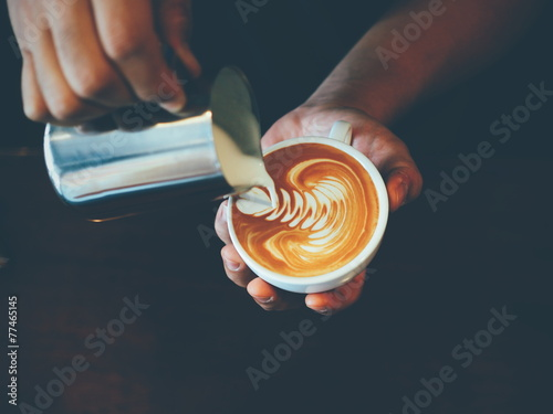 cup of coffee latte art in coffee shop Photo by chayathon2000