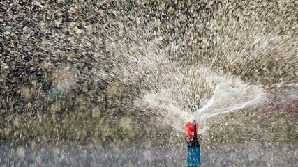 Close up water sprinkler, Dark background.