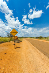 Australian Desert road with floodway sign