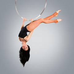Plastic beautiful girl gymnast on acrobatic circus ring in flesh