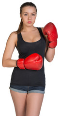Woman in boxing gloves posing