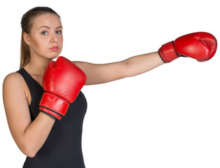 Woman wearing boxing gloves, in punching pose