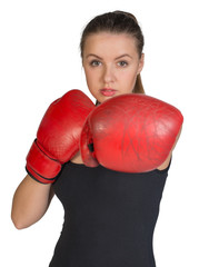 Woman in boxing gloves. Punching pose