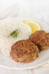 meatballs with rice and lemon on plate