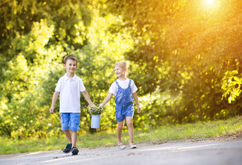 Little boy and girl on a walk