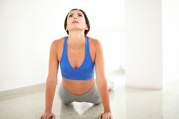 Female in yoga class looking up