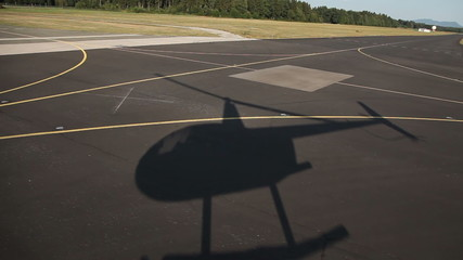 Shot of a heli shadow on road