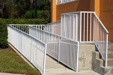handicap ramp with white railing