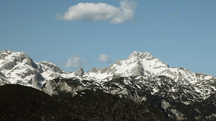 Mountain peaks in Slovenia on a sunny day with few clouds