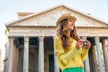 Portrait of happy woman with photo camera in front of pantheon