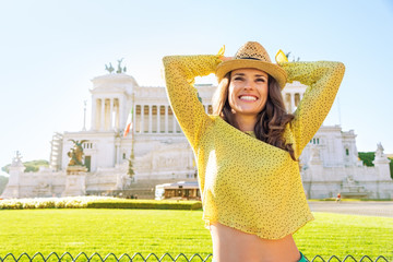 Portrait of happy young woman on piazza venezia in rome, italy