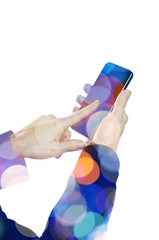 Female hand holding a smart phone with lights