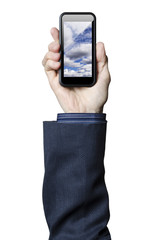 Hand holding smart phone with clouds on the screen