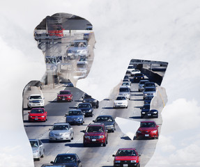 Woman with digital tablet composited with images of traffic
