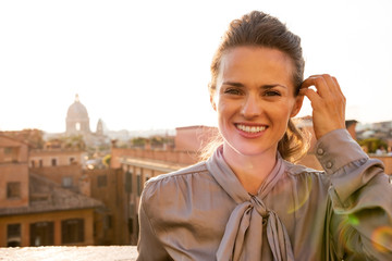 Portrait of happy young woman standing on street in Roma