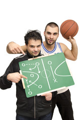 Basketball athletes pointing on blackboard,winning tactics