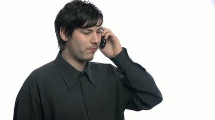 Portrait of businessman on cellphone talking in slow motion
