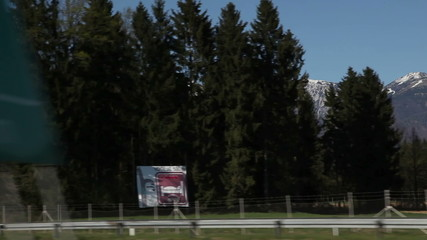 Shot of Slovenian mountains and landscape from the moving car