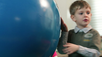 Close up on kids playing with Earth globe