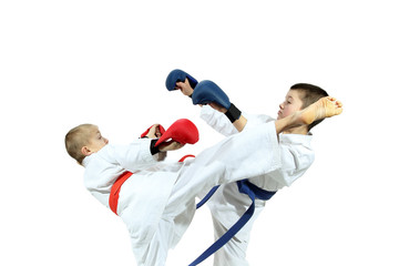 Athlete with a red belt kick another competitor on the head