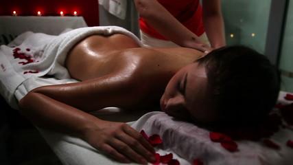 Woman enjoying sensual massage in a beauty spa salon