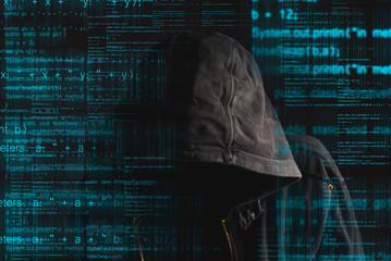 Faceless hooded anonymous computer hacker