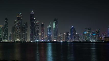 time lapse photography, night view of Dubai skyscraper