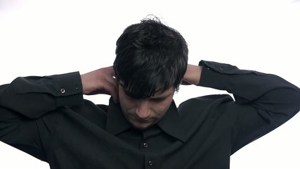 Fixing shirt collar in slow motion on white background