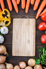 Cutting board with vegetables mix on the table
