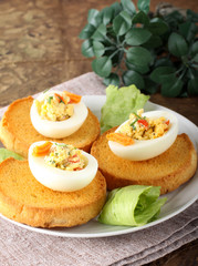 Egg stuffed with pepper, chives, mayonnaise
