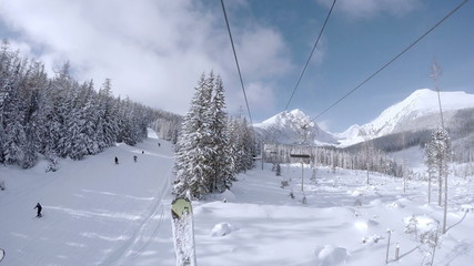 4K UHD Video: Ski lift in snowy Tatras Mountain resort