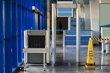 X-ray scanner and metal detector at harbor security point