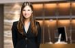 Leinwandbild Motiv Smiling female receptionist