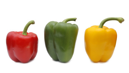 Composition with three peppers on white background