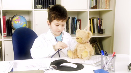 Future young doctor taking care of plush patient