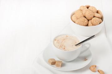 Amaretti Biscuits. Cup Of Cappuccino Coffee. Lump Demerara Sugar