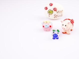 Glücksschweine mit Stein