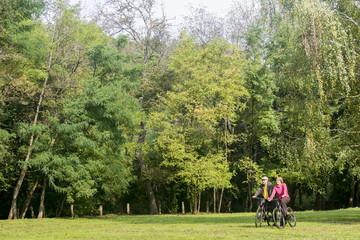 Senior couple riding bicycles