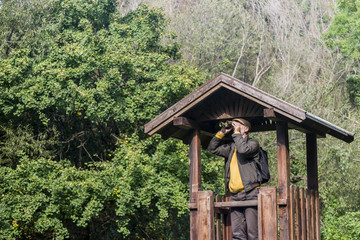 Senior man with binoculars